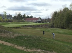 Nevin and Rob in the fairway on #1. The clubhouse in the background.